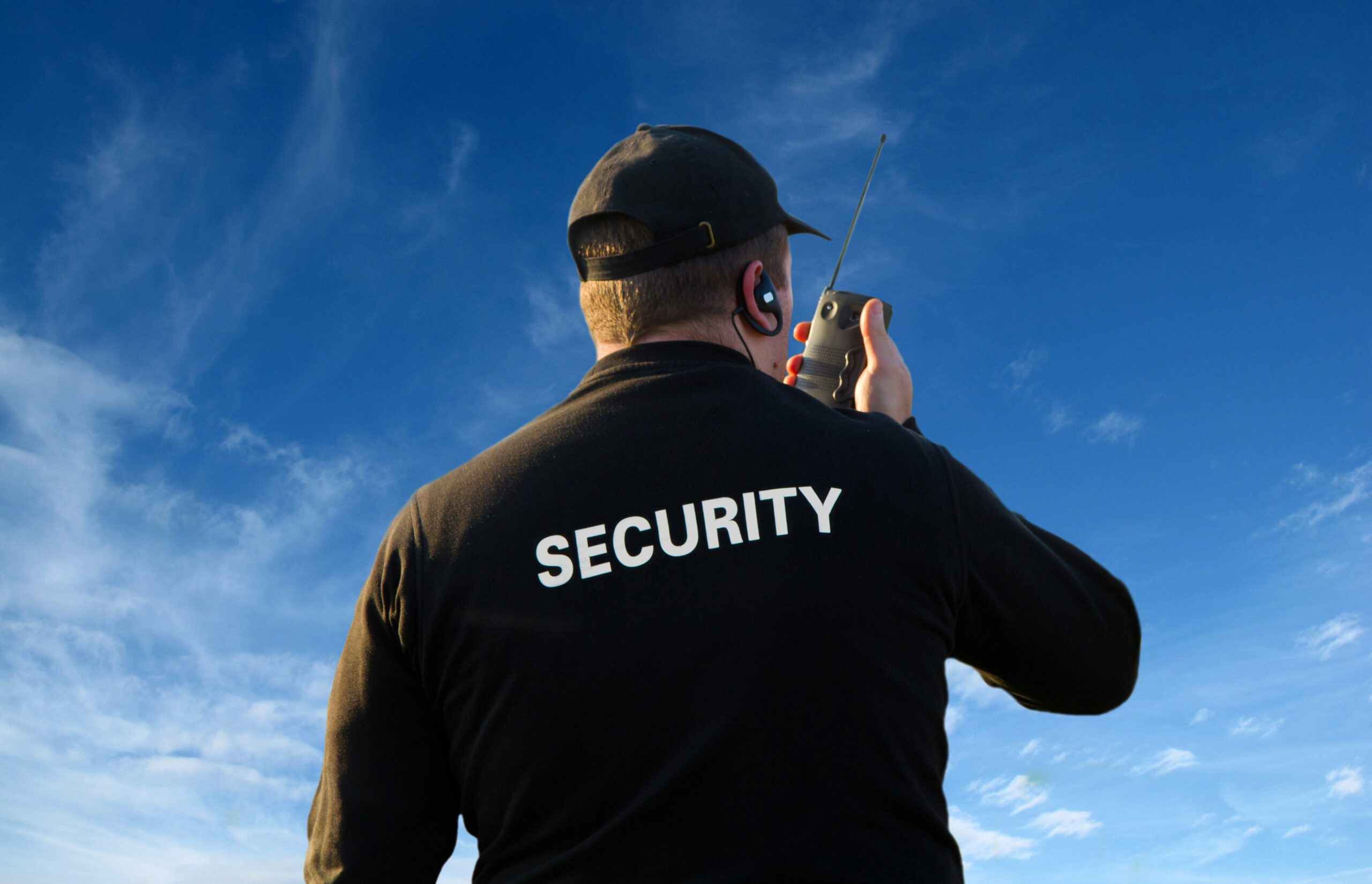 back of a security guard isolated on white